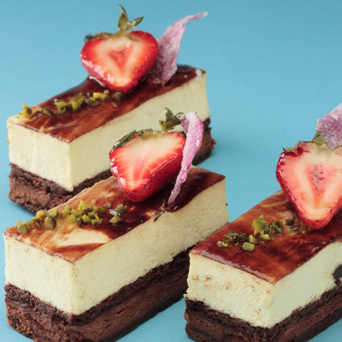 Our small Mint cake creation topped with strawberry and candied flower petals
